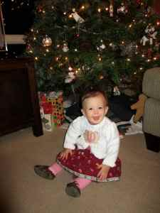 Ten months old, in front of the tree