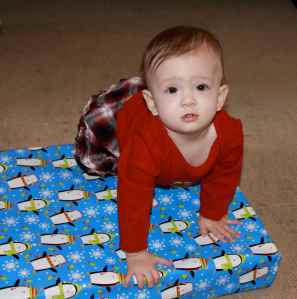 Climbing onto presents is pretty fun!