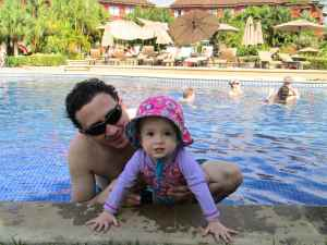 Hanging in the pool with dad