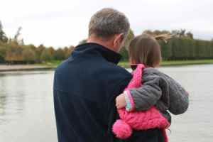 Checking out huge fish, swans and ducks in the Grand Canal with Papa
