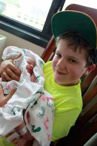 Cousin Kyle's first time holding you; he was so sweet and gentle with you.
