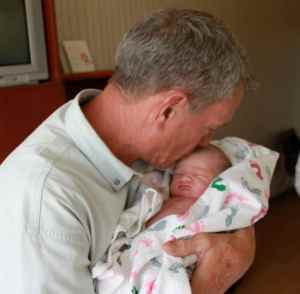 Papa's first time holding you and first kiss.